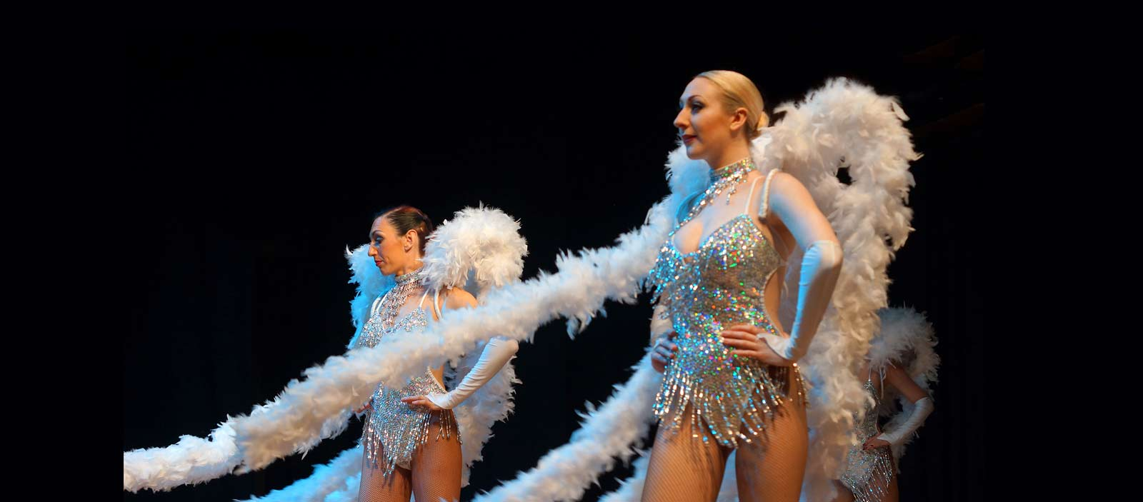 Las Vegas showgirls in silver and white costumes