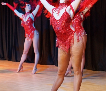 Las Vegas Showgirls  in red costumes
